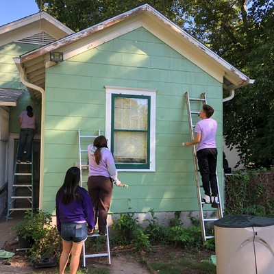 Habitat Repair team painting a house